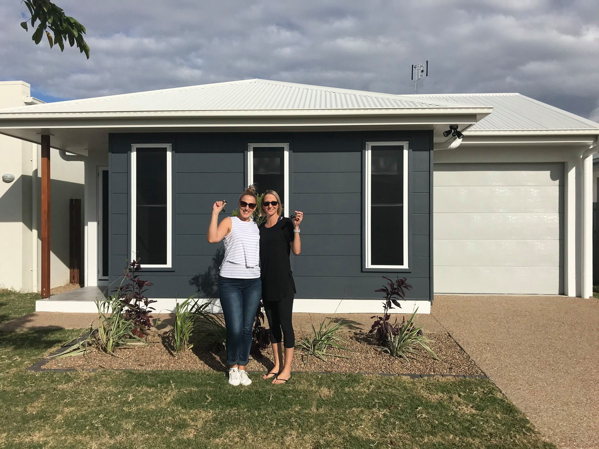 First-Home-Buyers-In-Front-of-house_Townsville