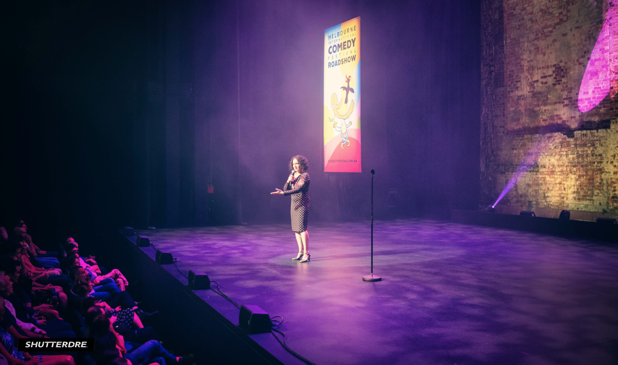 RACHEL PERFORMING AT THE MELBOURNE COMEDY FESTIVAL.