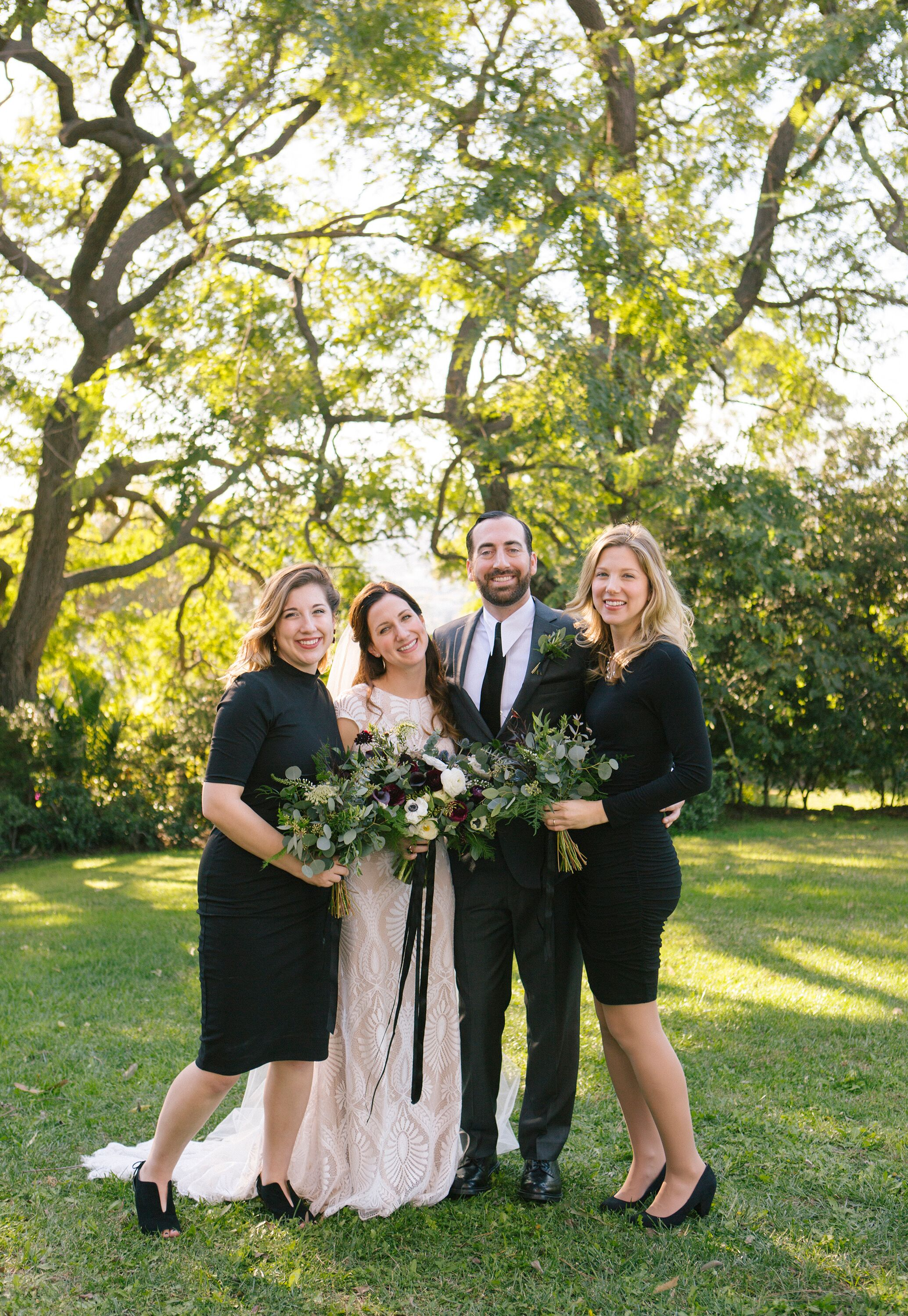 Lorie & Adam with bridesmaids- Photo by Rainbeau Tharp