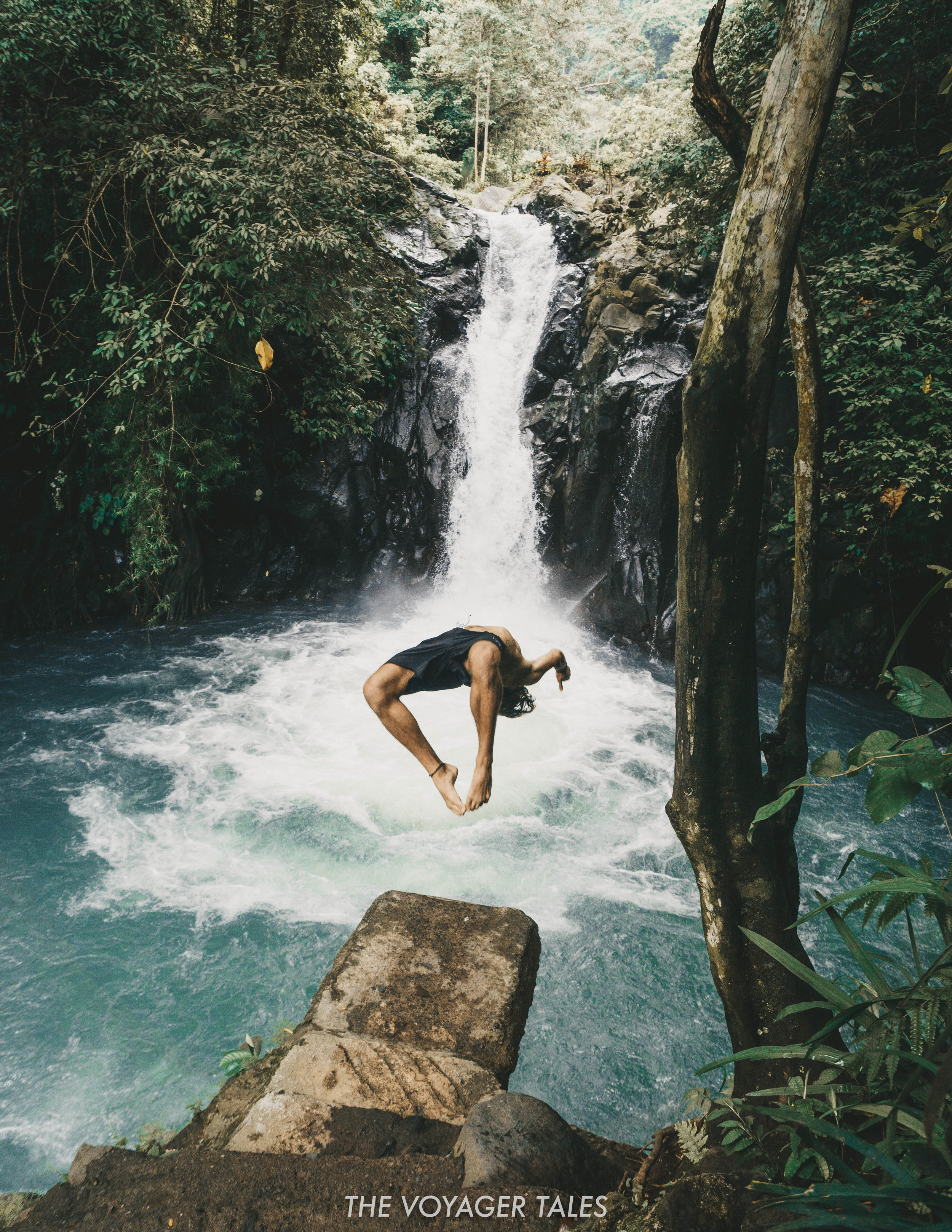 Kroya Waterfall cliff jump backflip.jpg