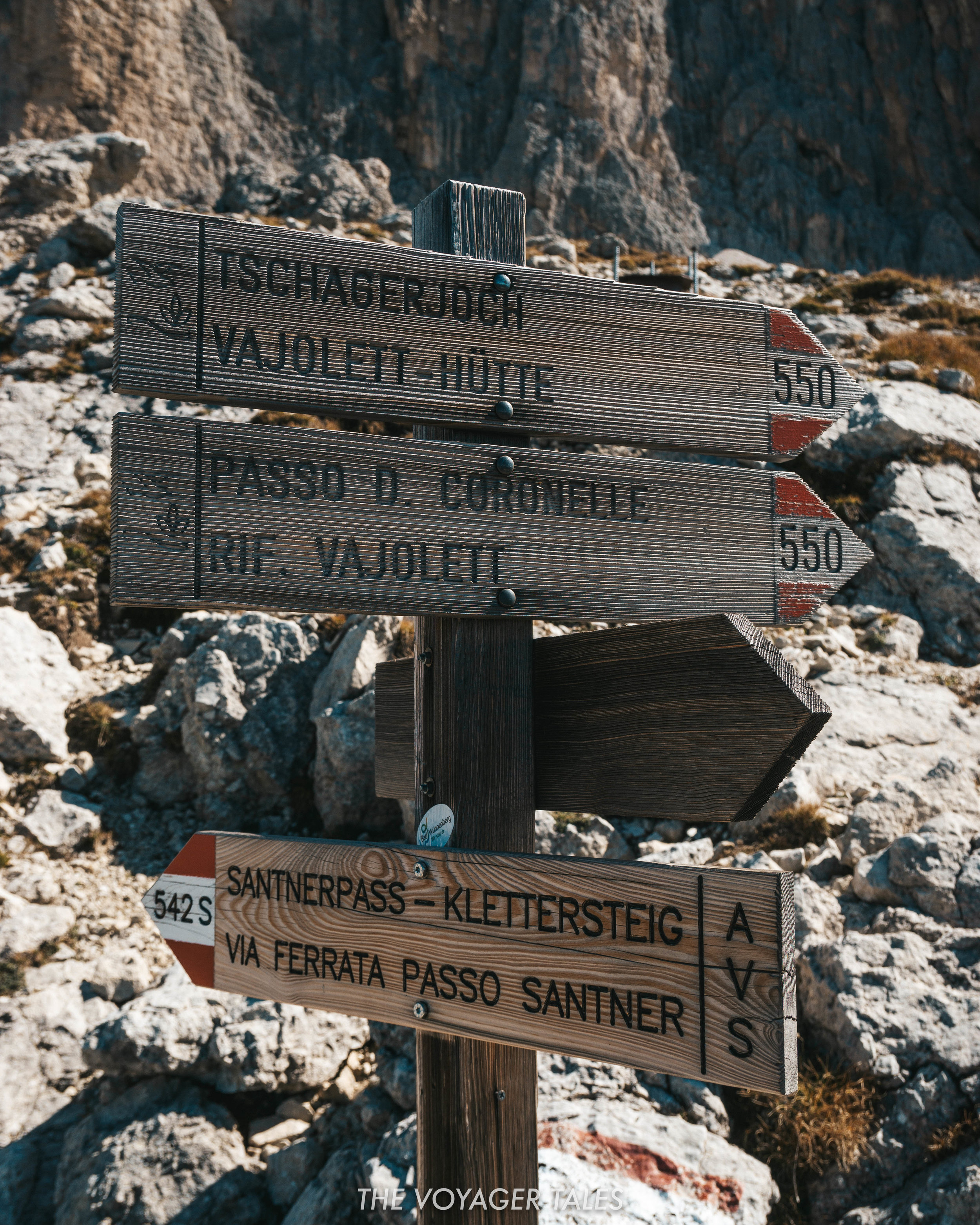 Signposts for the Vajolet Towers hike in the Dolomites, Italy