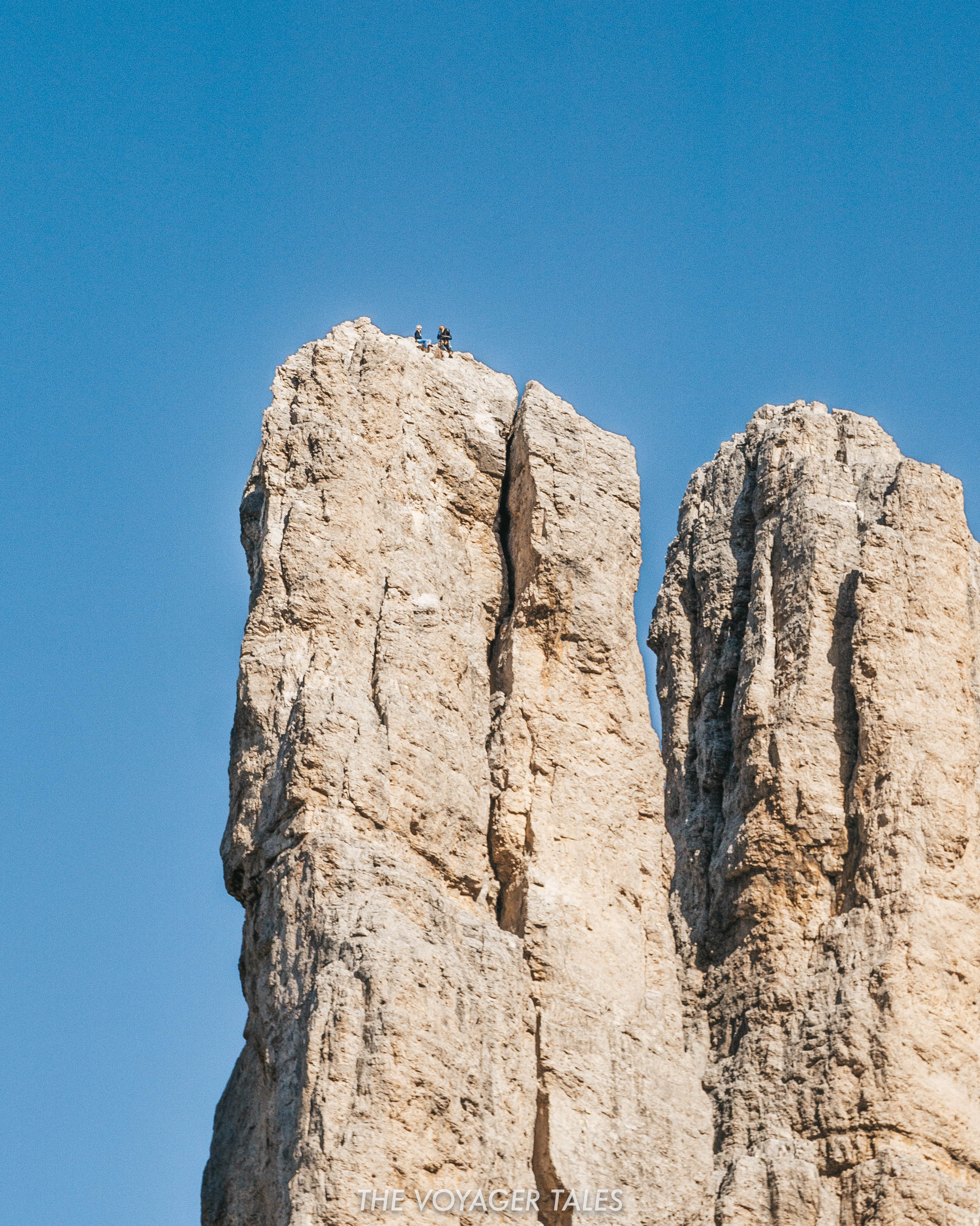 Rock climbers enjoying the view from the summit of the Vajolet Towers, Italy