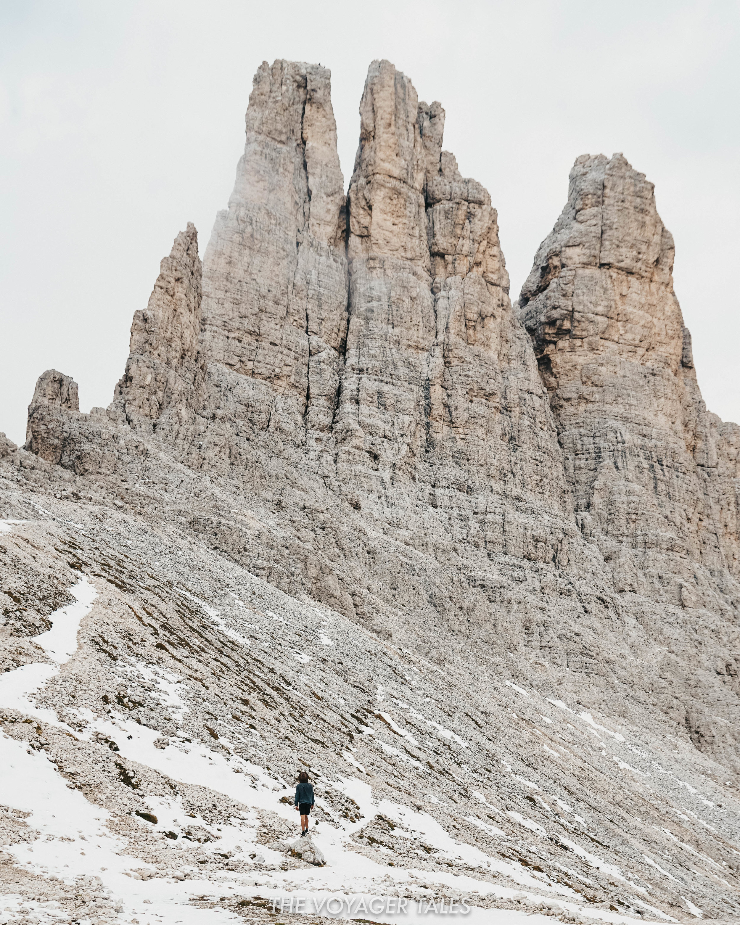 The Vajolet Towers amidst snow clouds in the Dolomites, Italy