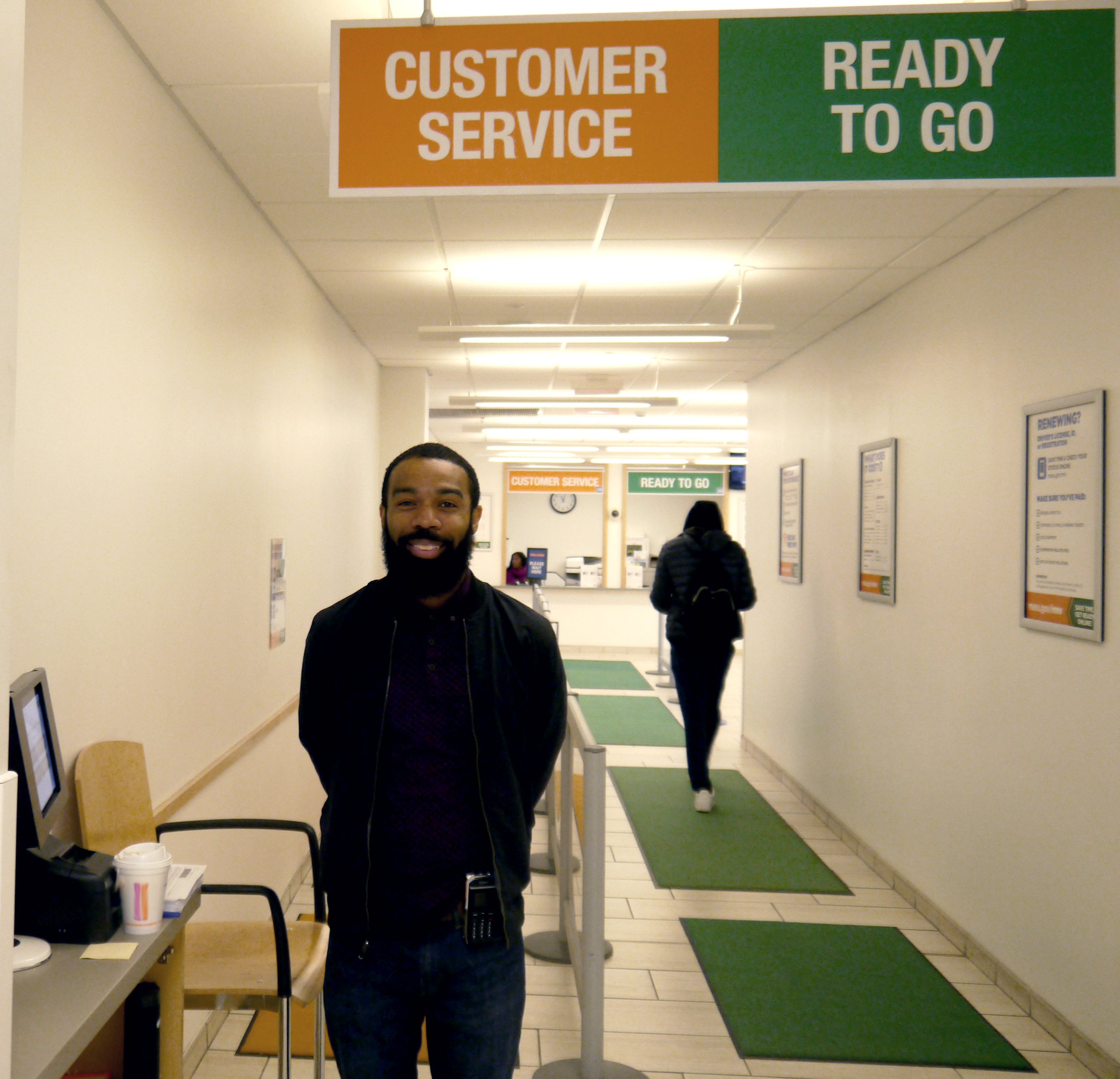 Image of an RMV Service Center greeter.