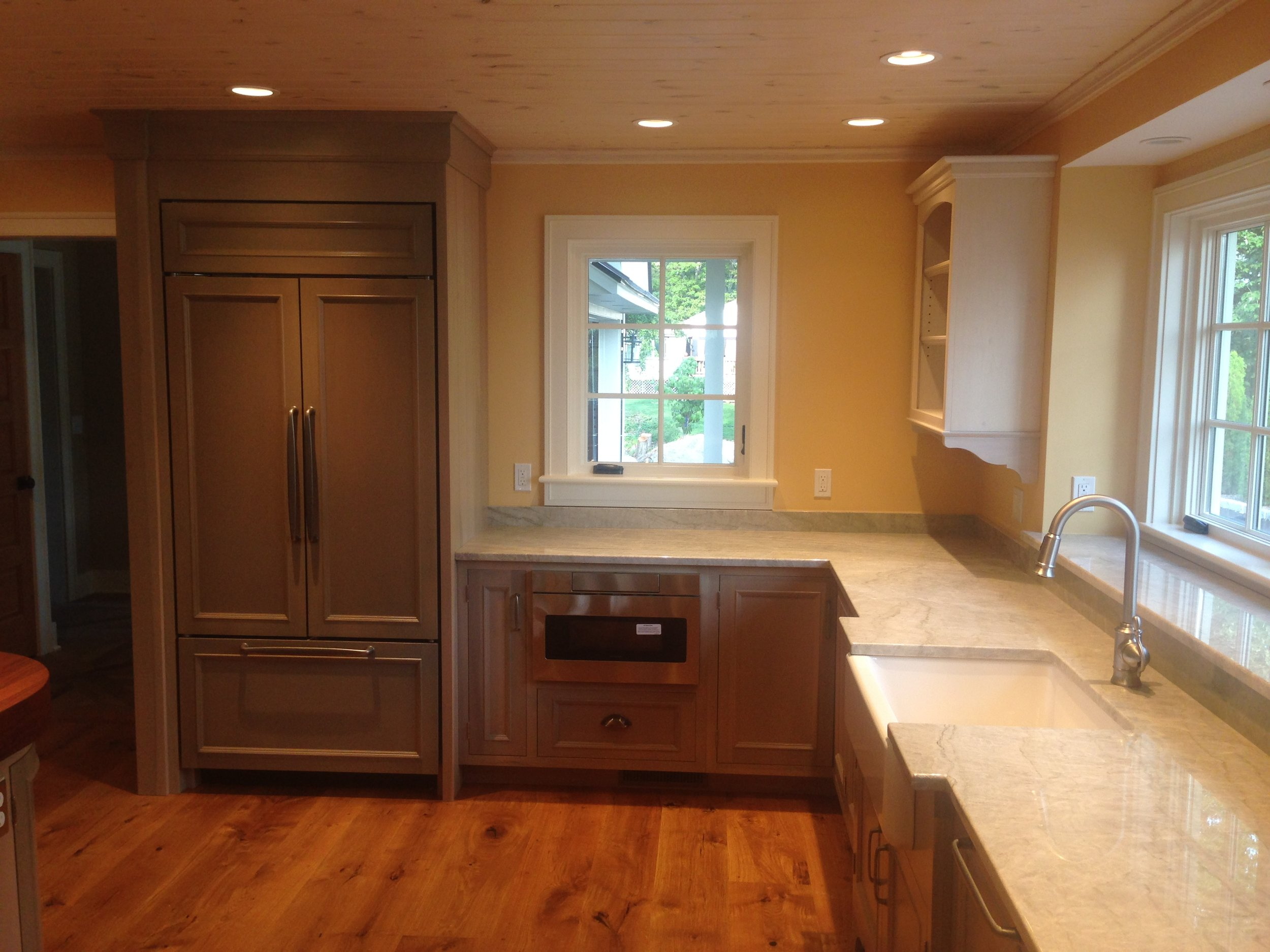 A Cottage Kitchen in Semi-Transparent Sage Lacquer, Quartzite Countertops, and Whitewashed Uppers 2.jpg