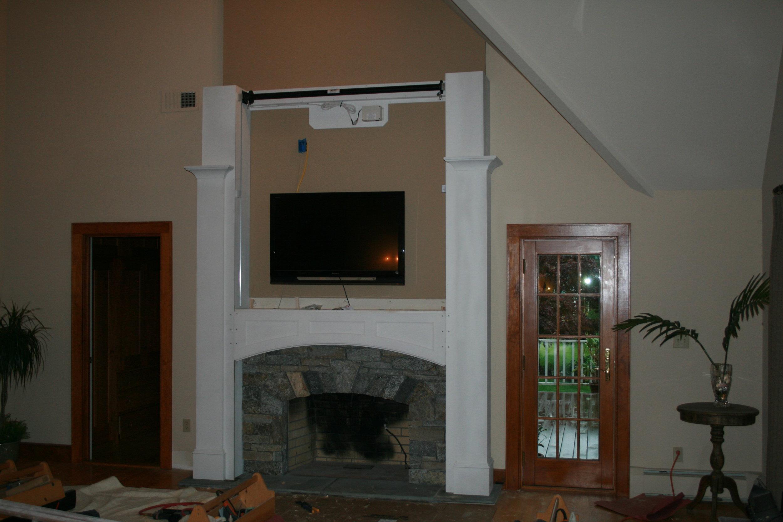 Fireplace Surround with Motorized Panel Lift 6.jpg