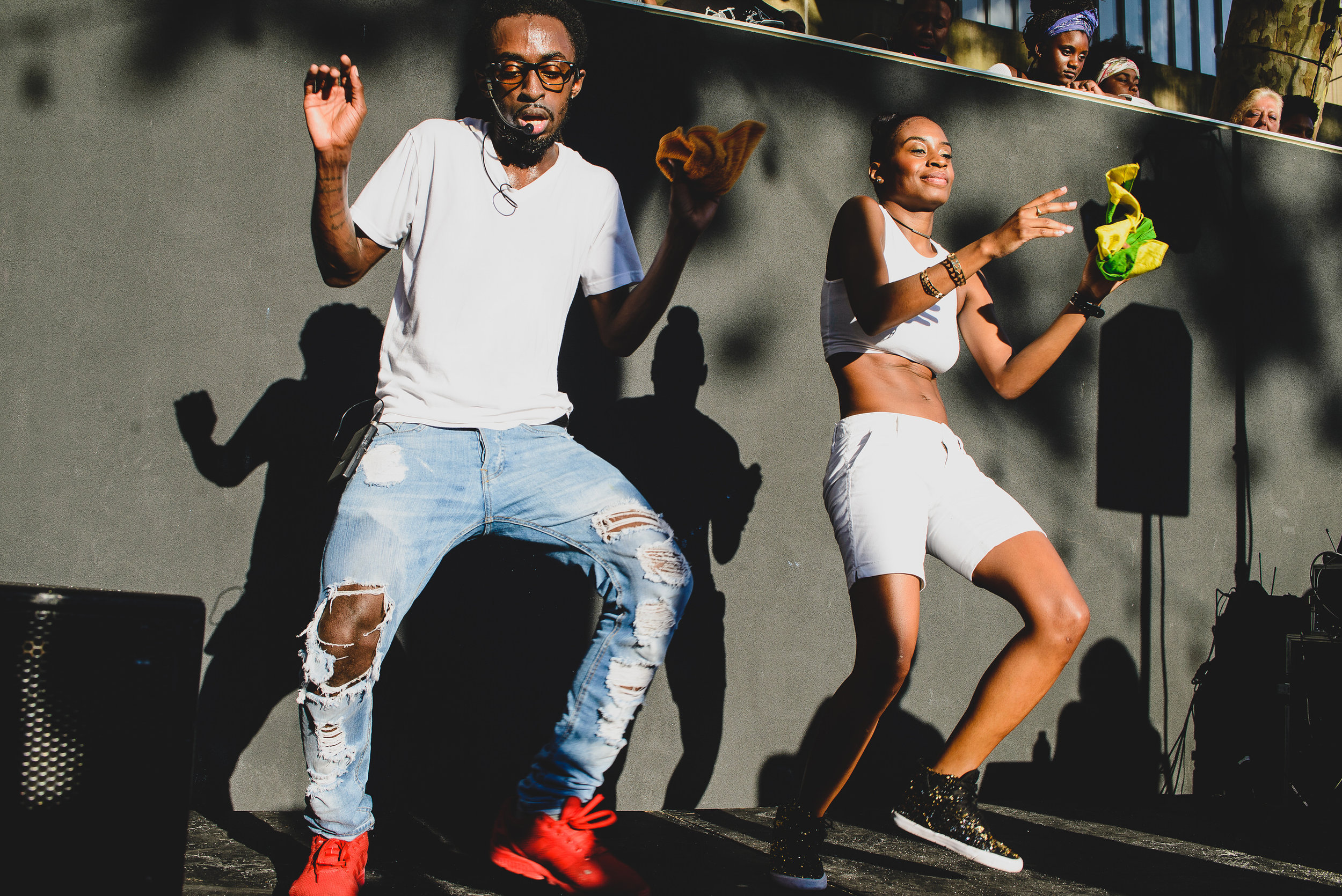 Dancehall choreograher Blacka Di Danca with Nelly Danca teaching a dancehall workshop to the crowd at Brooklyn Musuem's CaribBEING Target First Saturday