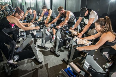 group-of-fit-people-working-out-on-spinning-class.jpg