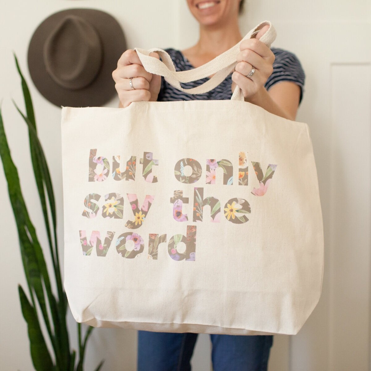 """Taken from Matthew 8:8, this charming  """"But Only Say the Word Tote Bag""""  reminds you that what you humbly ask of Him is heard by the almighty, all powerful One."""