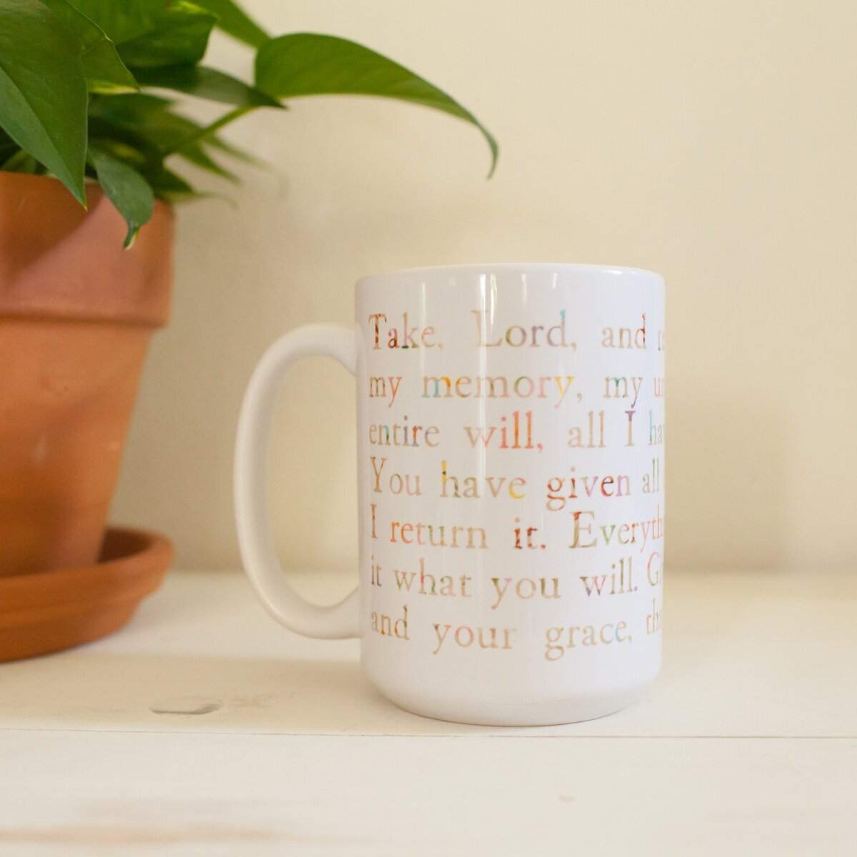 """As you wrap your hands around this stunning  """"Suscipe Mug""""  in the morning, we hope that the beautiful prayer of St. Ignatius may sustain you throughout the day."""