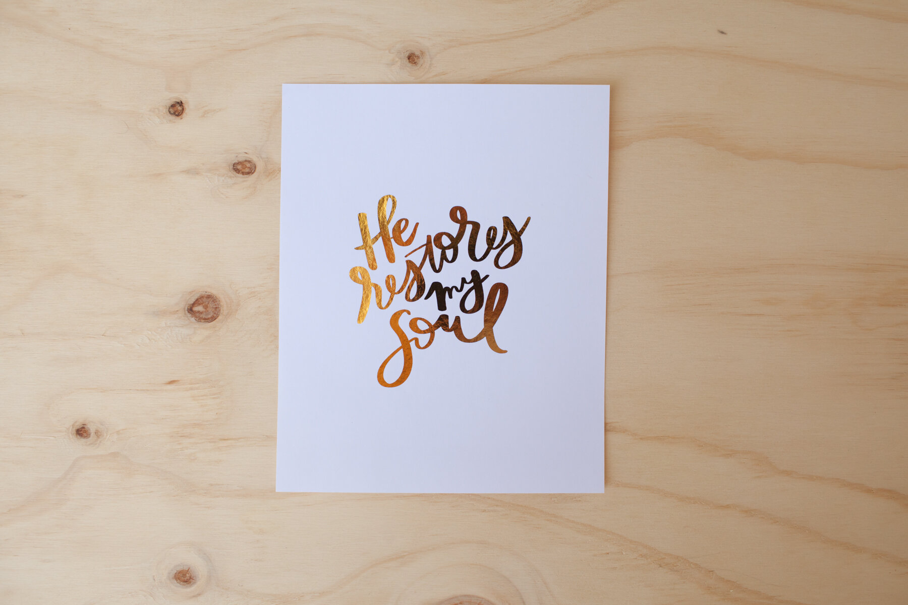 """Illuminated in gold foil, the truth of His love for you shines through. """" He Restores My Soul Print """""""