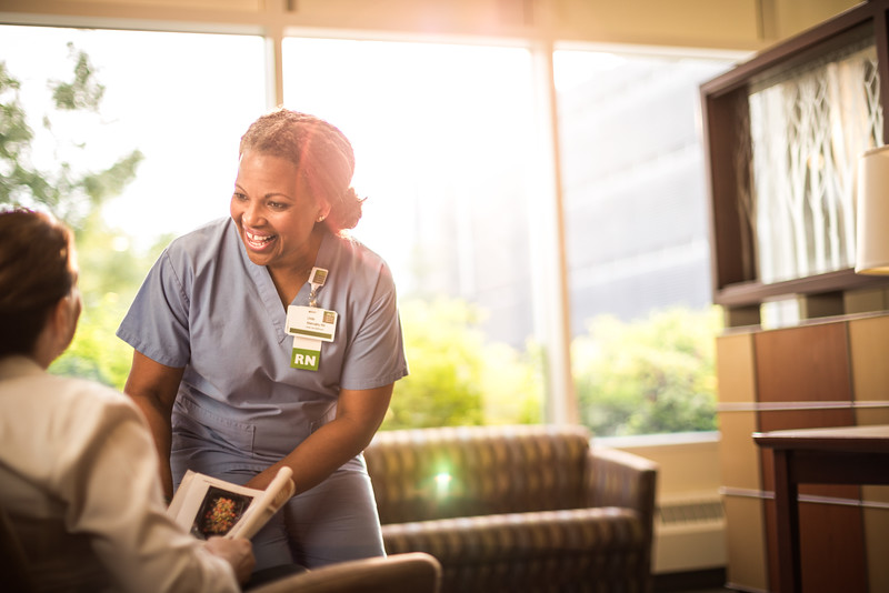 Nurse-Greeting-Patient-in-Sunny-Lobby-L.jpg