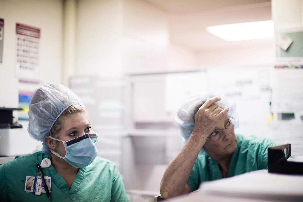 Two-Nurses-Concentrating-on-Monitors-near-Nurses-Station-X2.jpg