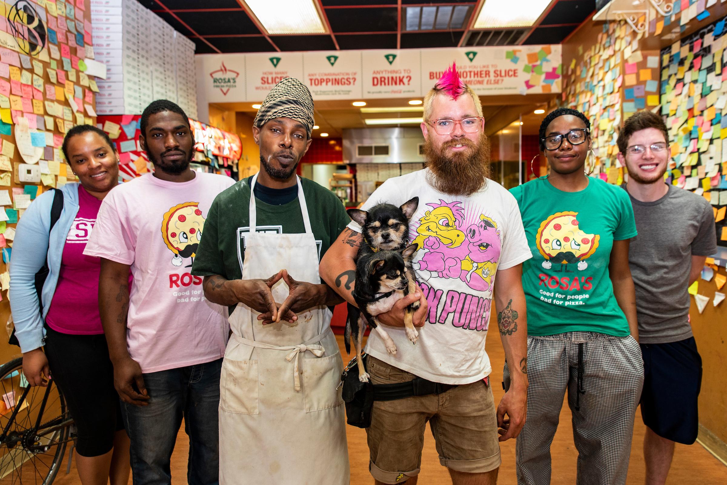 Joe Cox (center) with Brielle Harbin (far left), Max Robert (far right) and staff at Rosa's Fresh Pizza in center city.