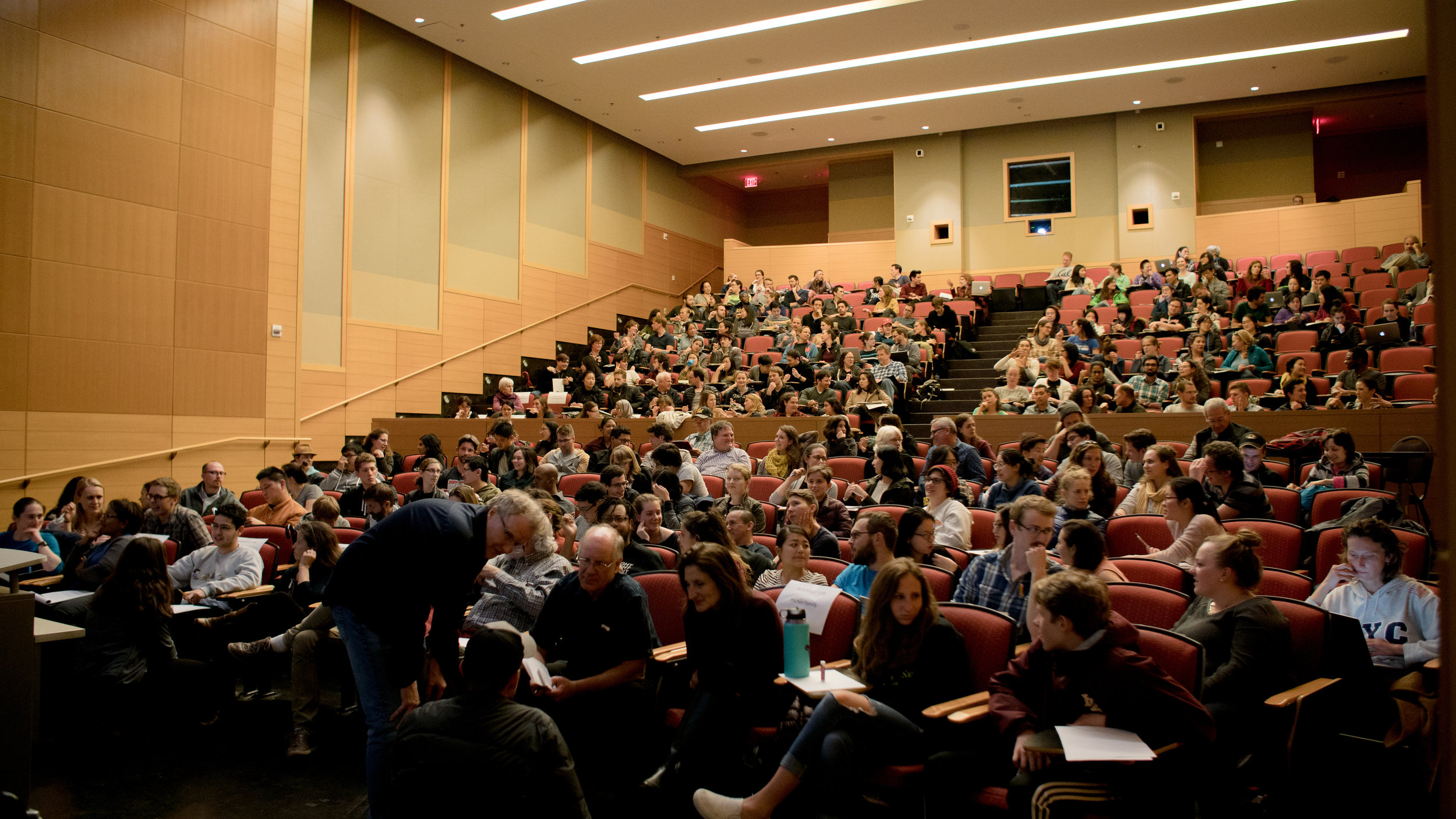 Over 250 participants engaged in small group and whole-audience discussions at a visual storytelling workshop at UC Berkeley in March 2018. Photo courtesy of Helina Chin, UC Museum of Paleontology.