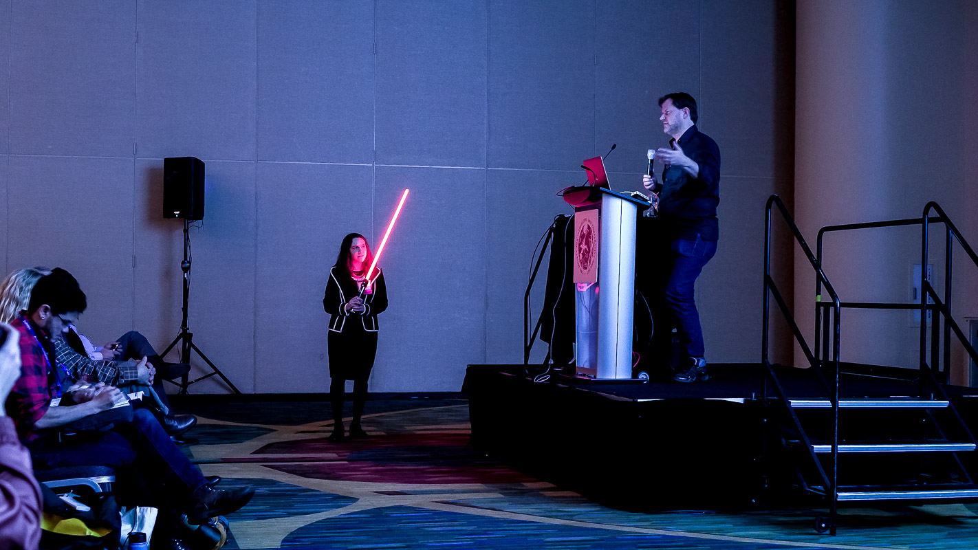 A lightsaber was used to keep the speakers on time, including Glen McIntosh (right), an Animation Director at Industrial Light & Magic.