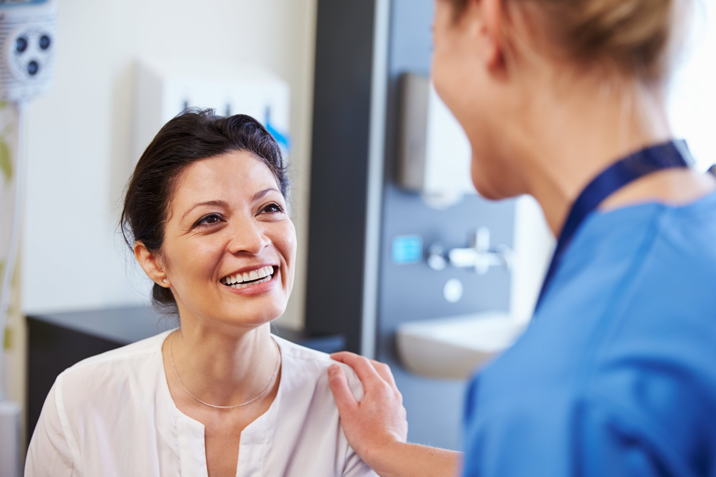 A Patient Smiling at a Healthcare Provider - Beacon Biomedical