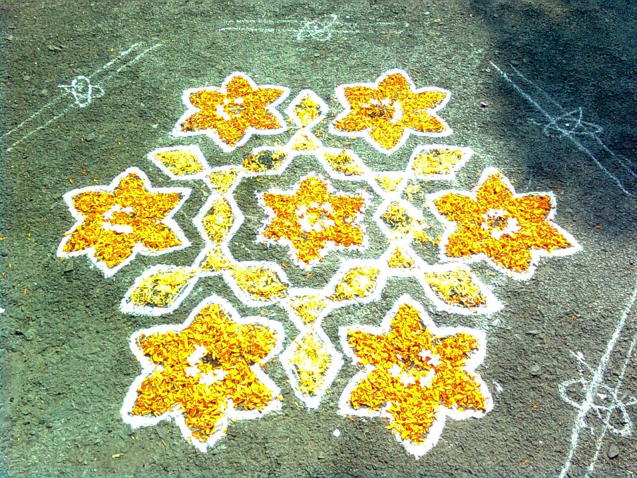 Sankranti_Muggu_with_flowers_at_Nizampet.jpg