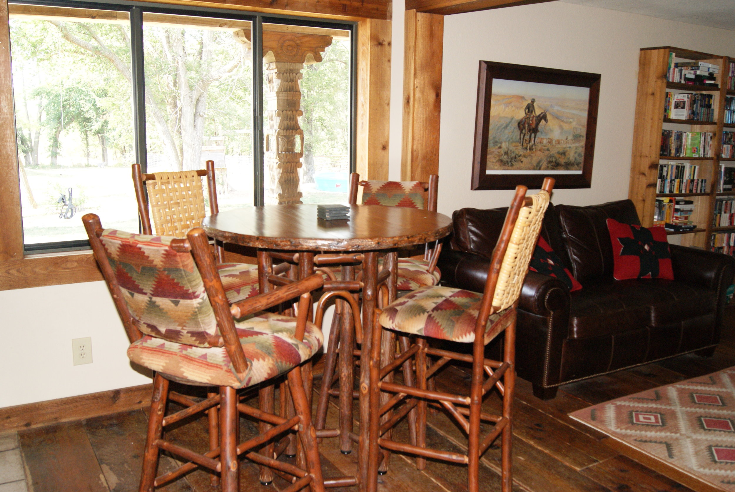 The Lodge West high-top dining area