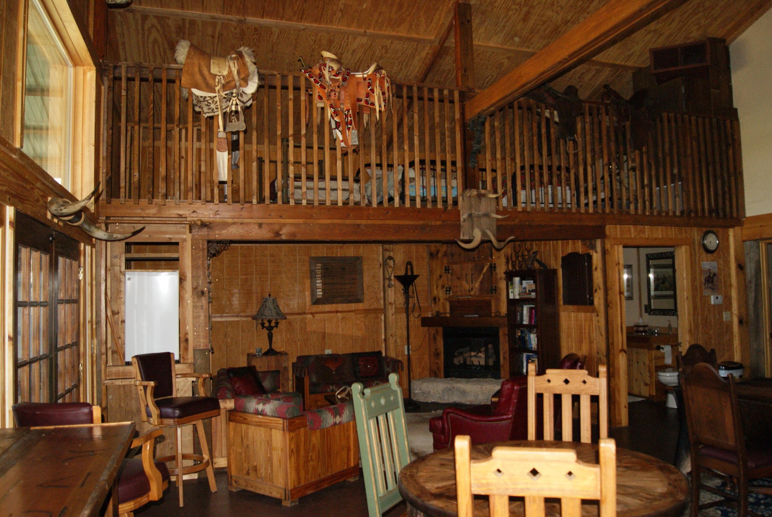The Lodge East lounge area, loft, and bathroom