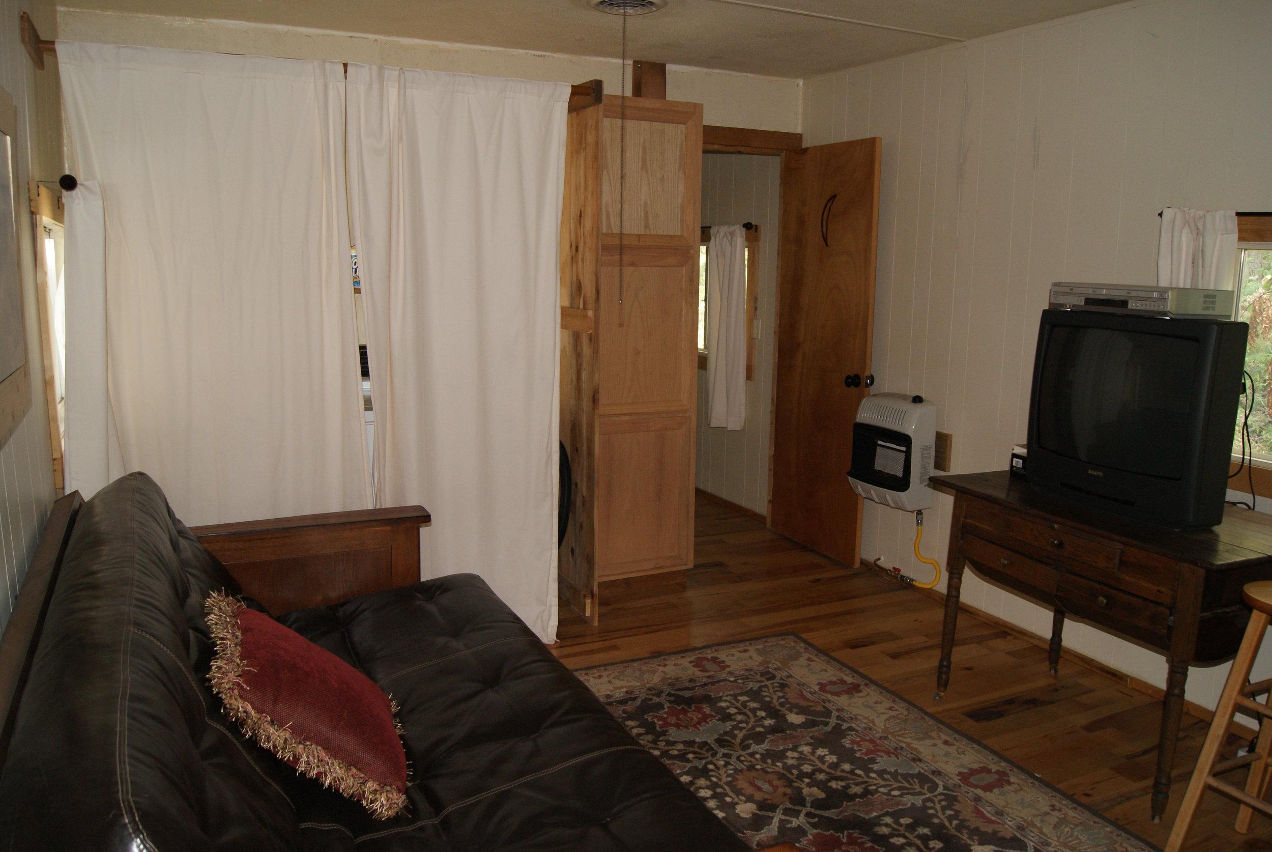 The Bunkhouse: Kansa living area, bathroom entrance, laundry (behind curtains)