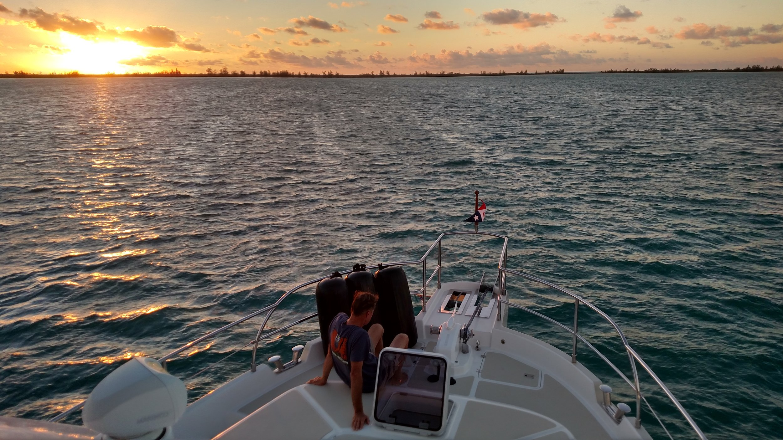 Captain Dan & the sunset at our anchorage at Great Sale Cay. Photo Larry McCullough