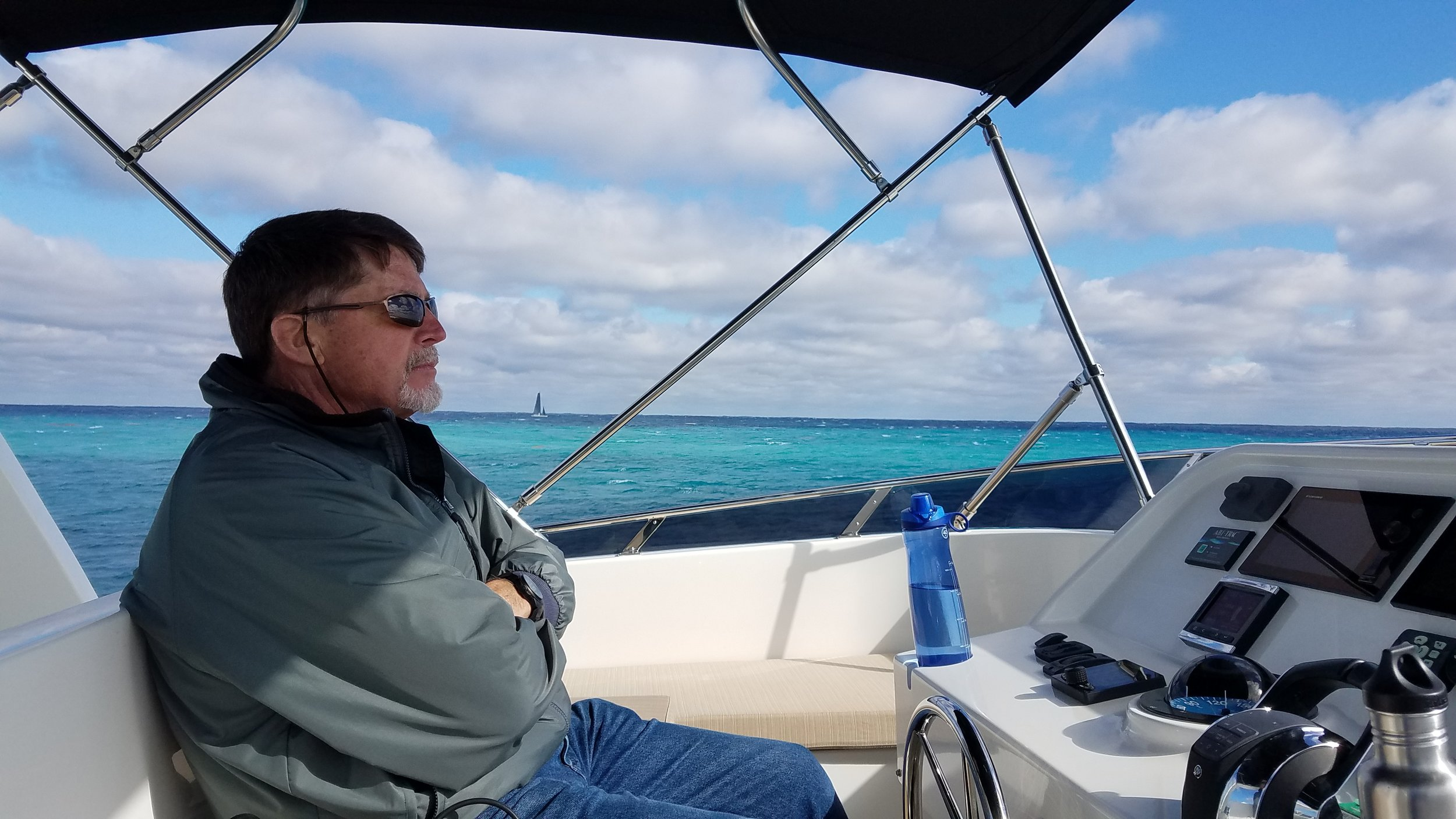 Seven foot swells look good on this guy…at least we had the auto-pilot that day on our way to Miami