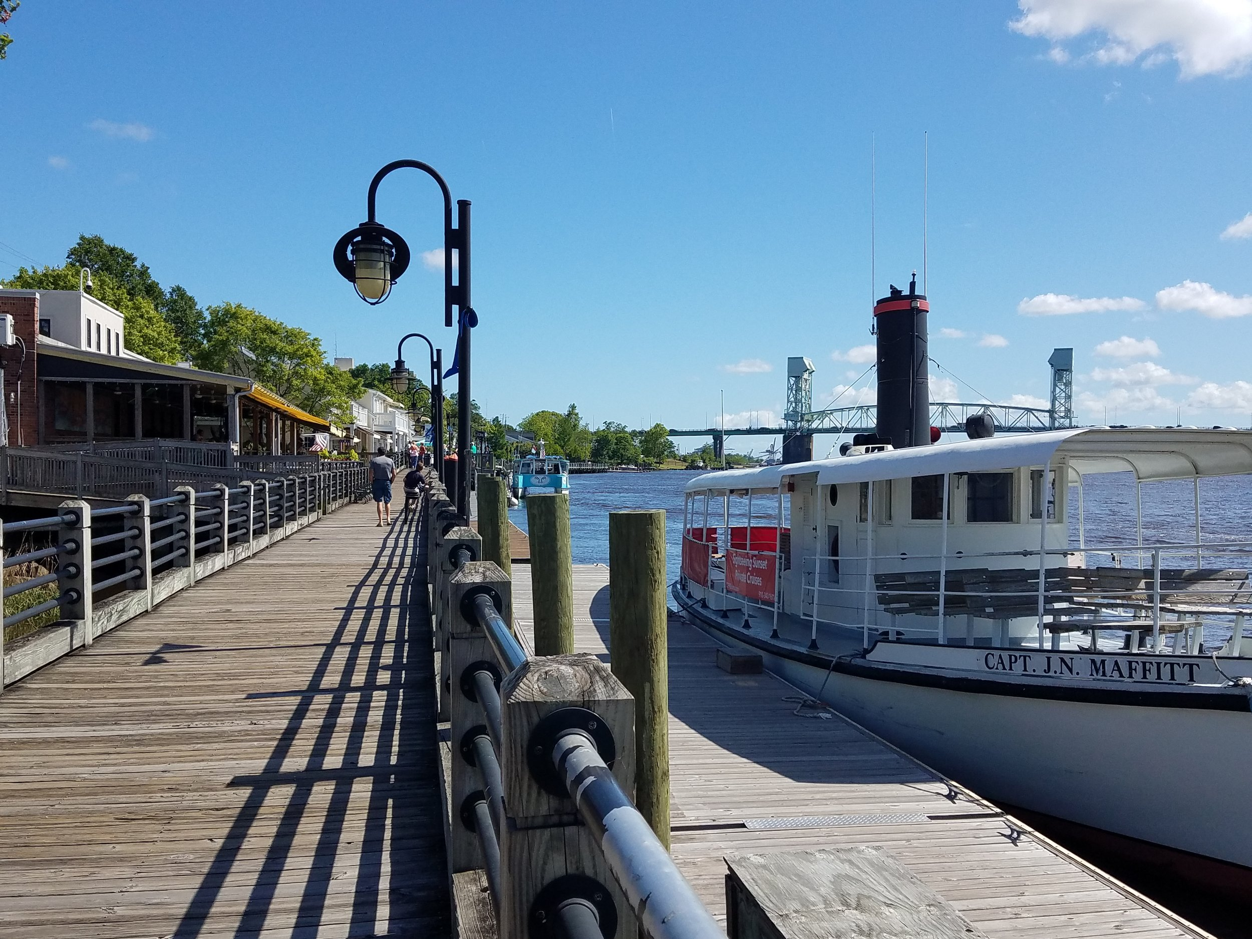 The boardwalk in Wilmington , NC along the the Cape Fear River