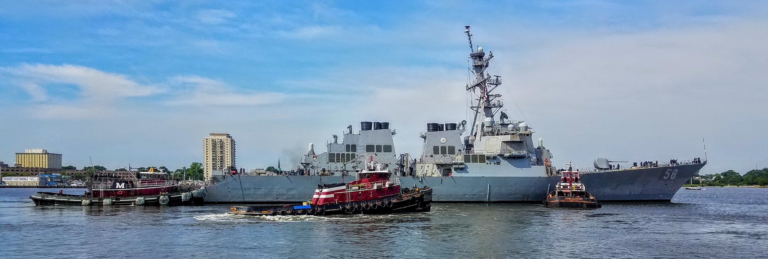 Leaving Norfolk for Cape Charles. War ship 58 being moved by my favorite tugs. Larry had to hail the War ship 58 to get permission from their captain to pass.