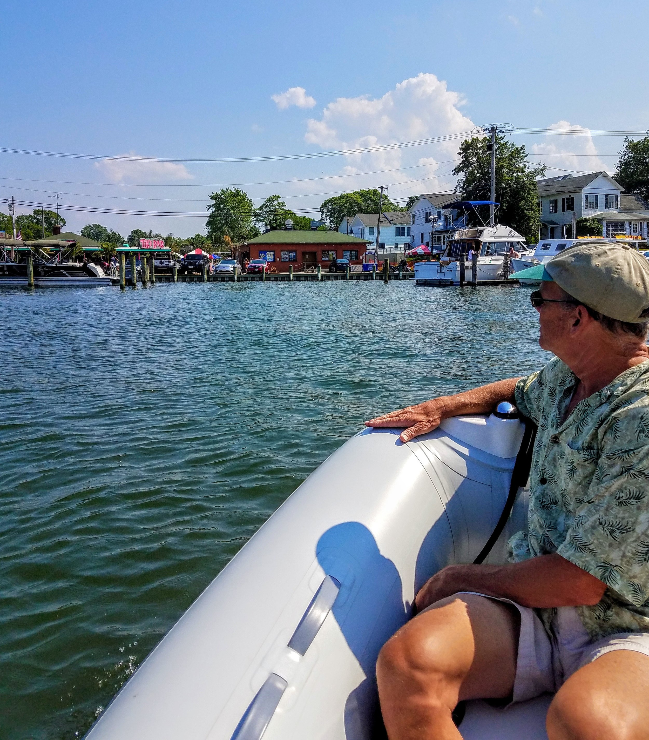Taking the tender to the legendary 'Tiki Bar' of Solomons Island.