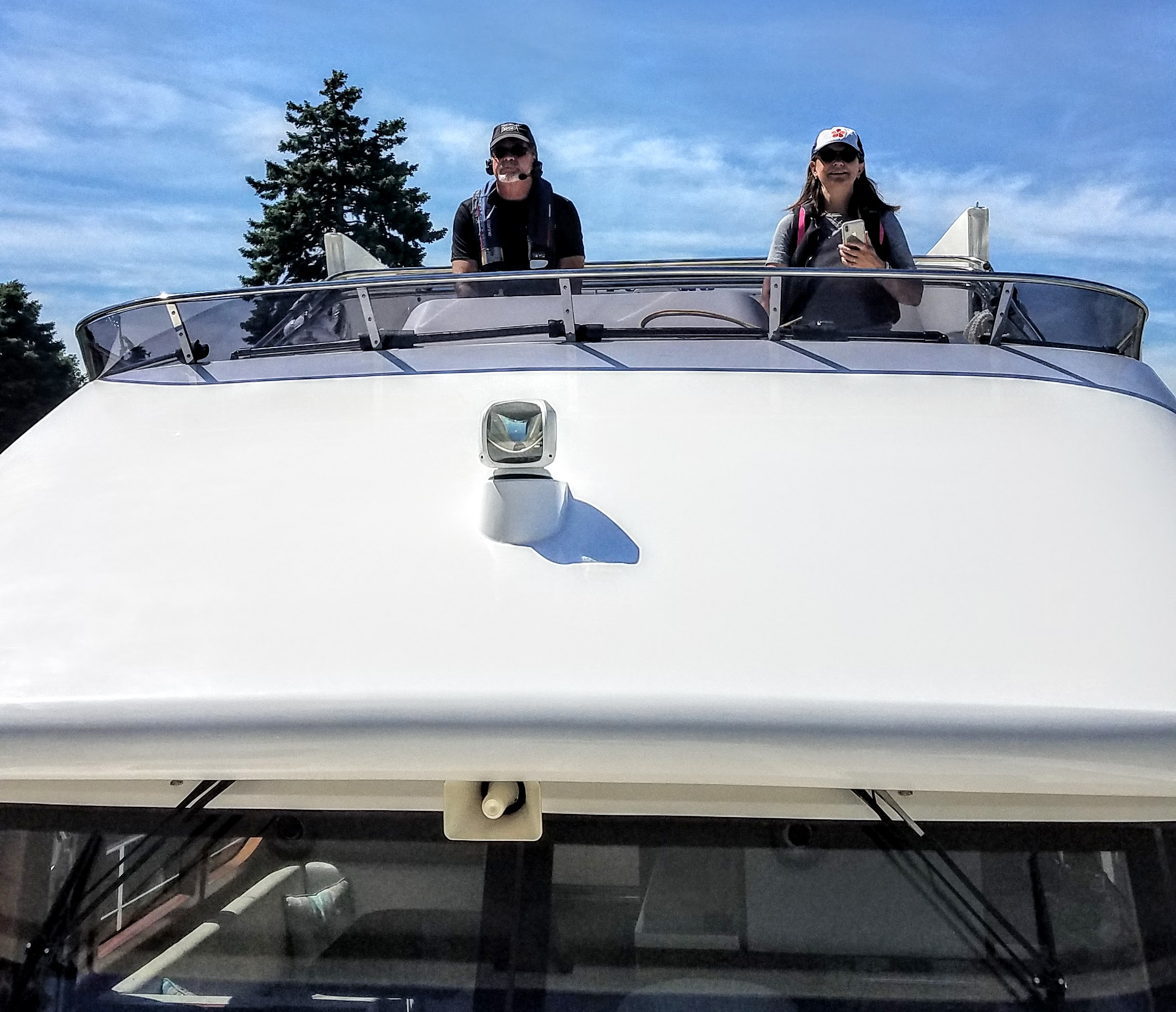 Captain Larry and Julia Lennon hold the helm station