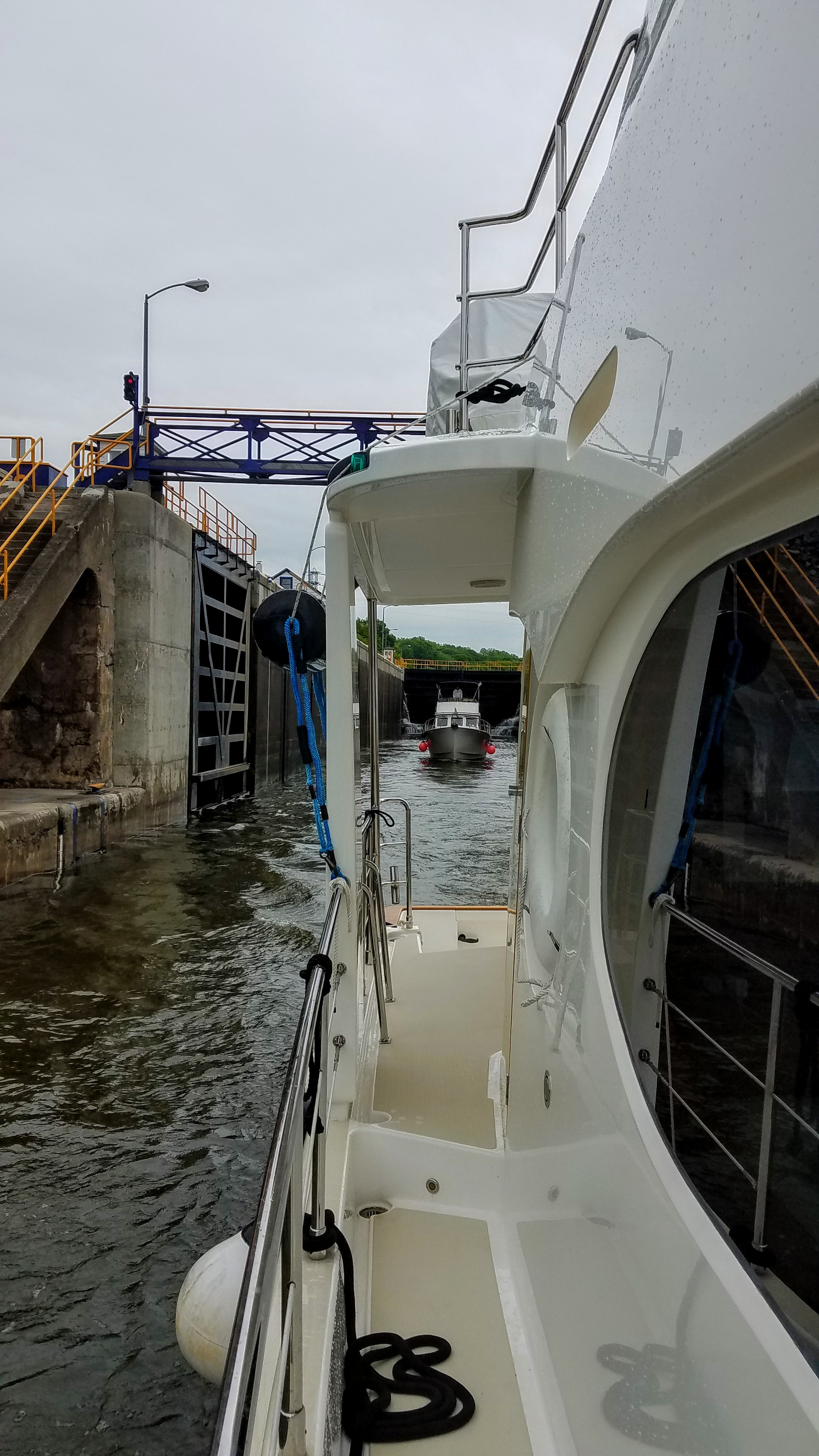 Exiting lock 6 of the Oswego Canal shadowed by the Comet