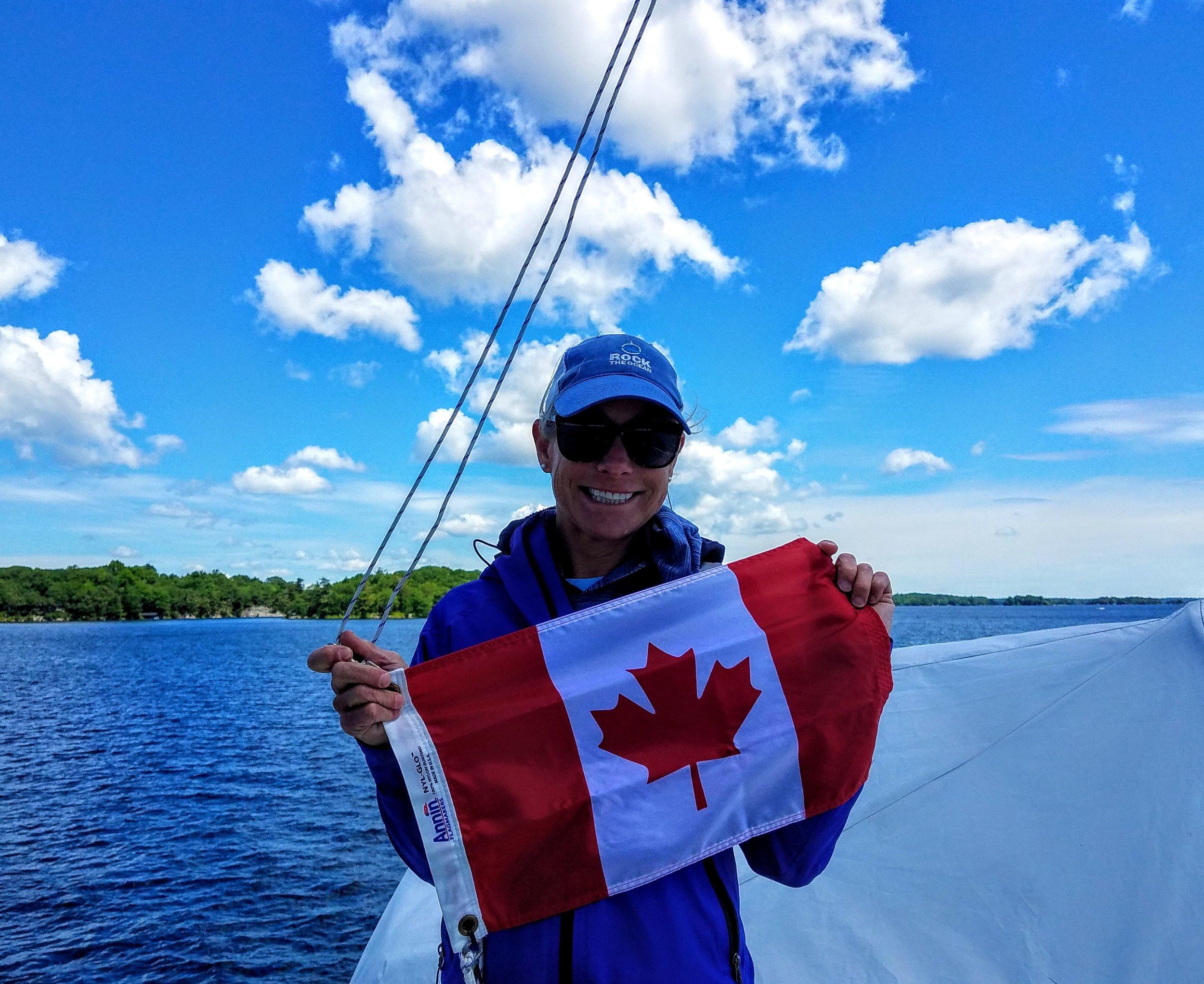 Hoisting our International Canadian Courtesy flag. Photo Owen Doherty