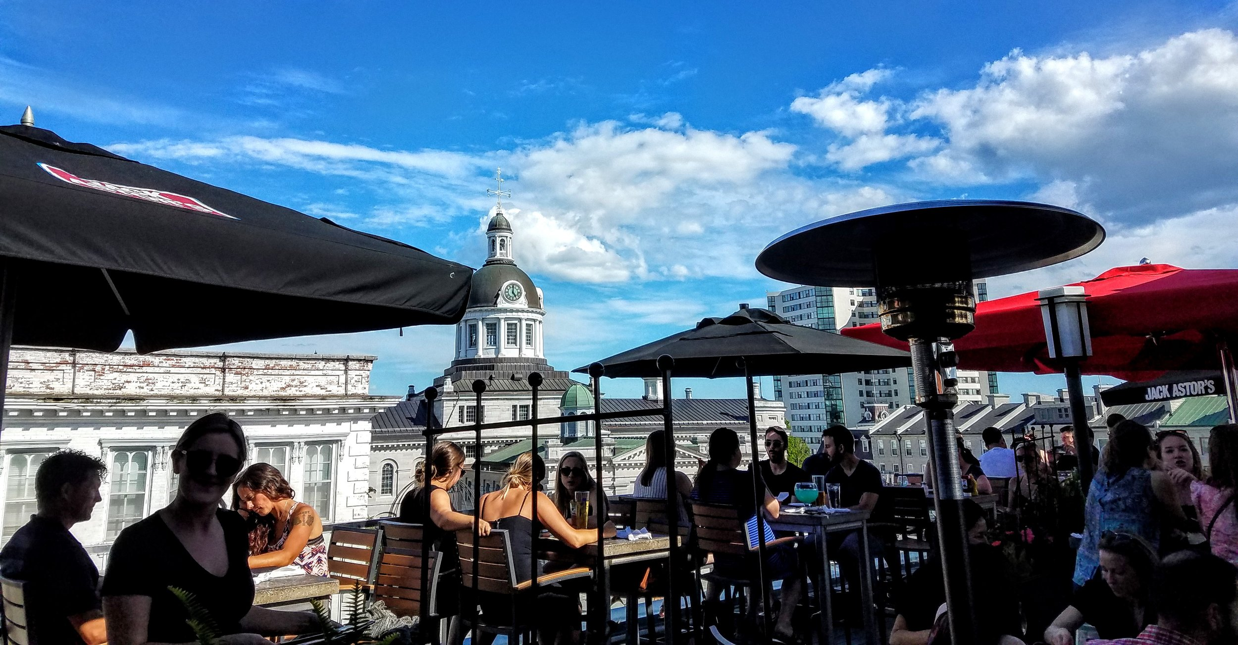 A busy first day of summer on a roof-top restaurant over looking the Kingston City Hall