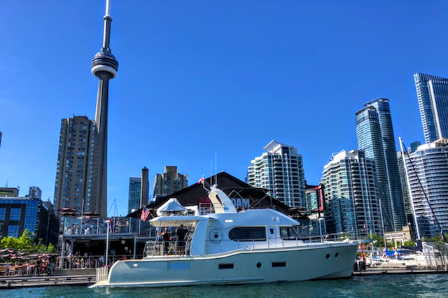 Thanks to dock master Maurice Landry, who took this great image of the Independence at her posh spot in front of the Toronto city skyline.