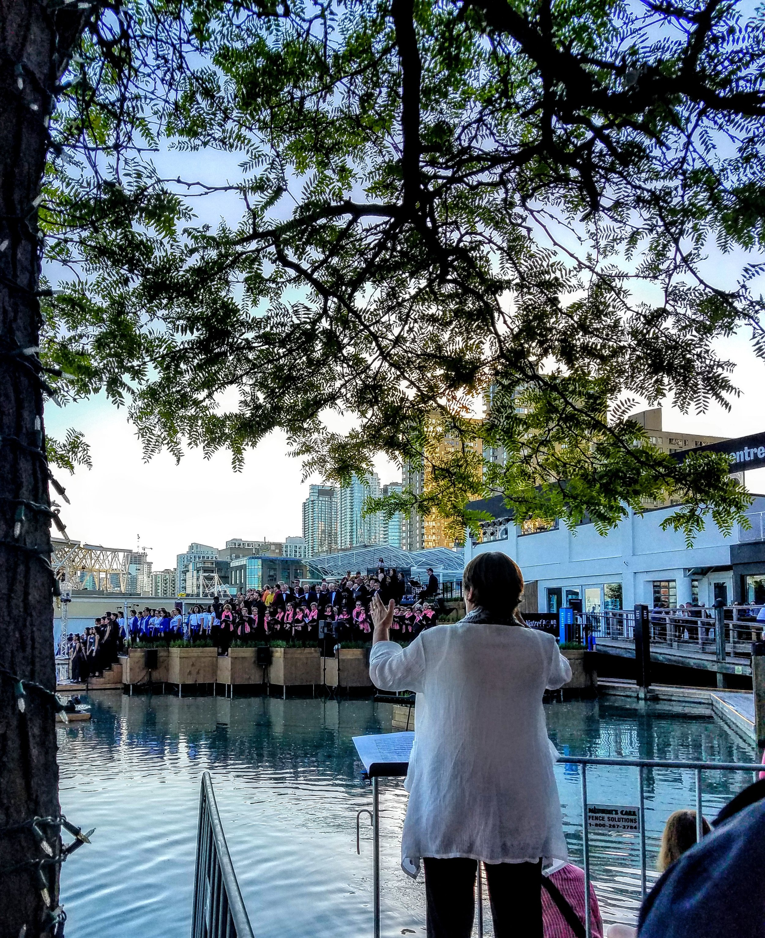A choral concert at the waterfront at twilight