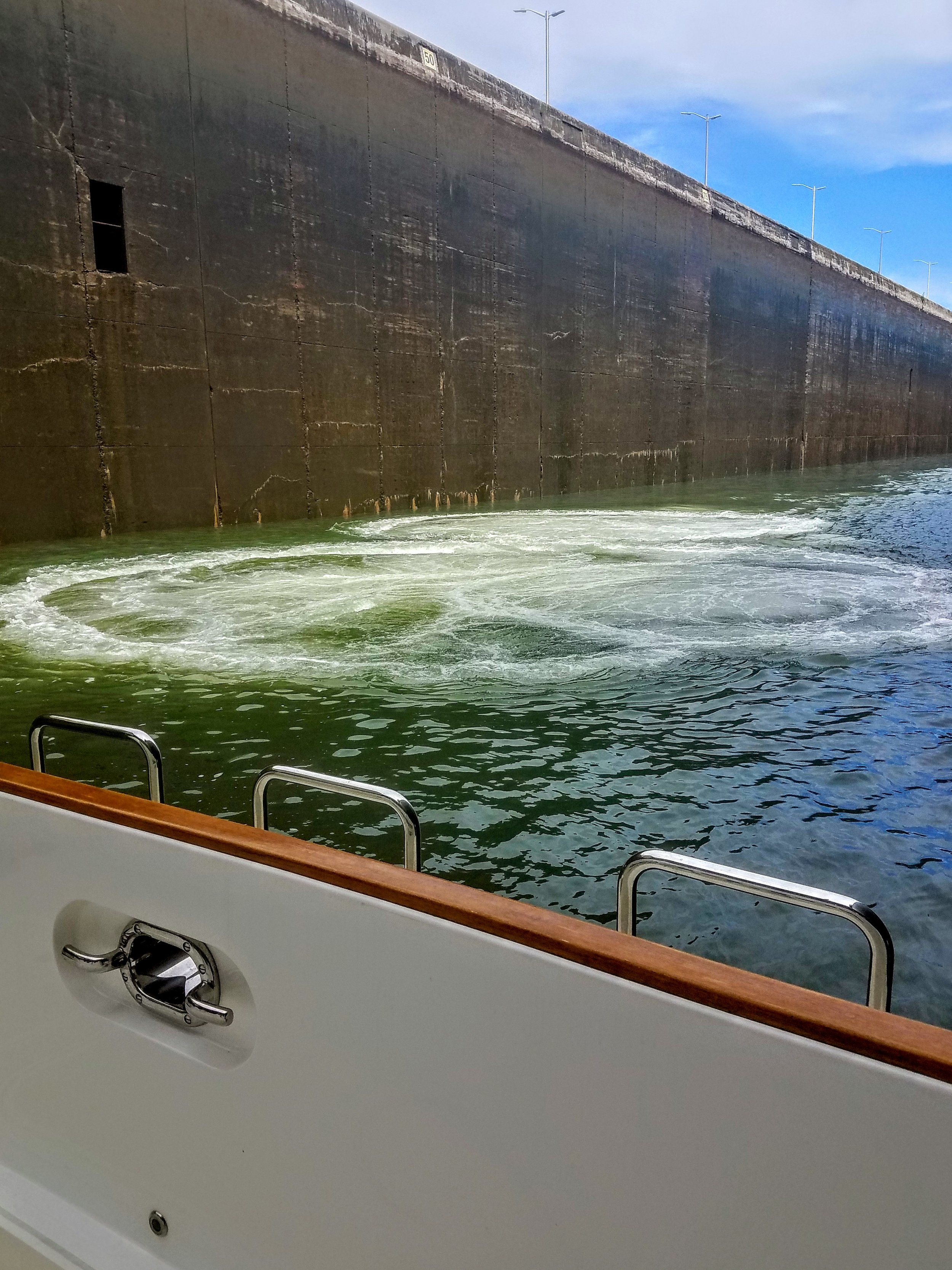 The water boils up from massive valves below the hull of the boat