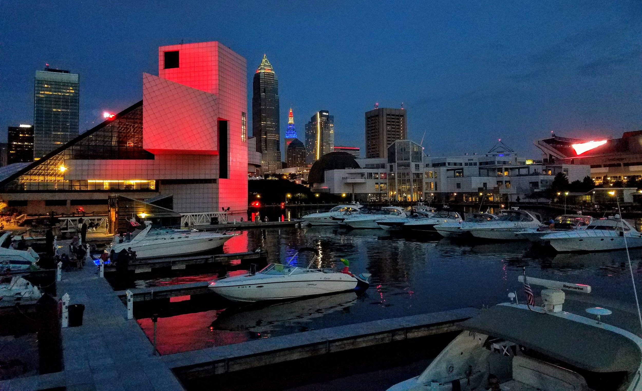 Back at the North Coast Harbor Marina on the night of the fourth of July with the Rock and Roll Hall of Fame dressed in Red and the Terminal Tower in Red White and Blue