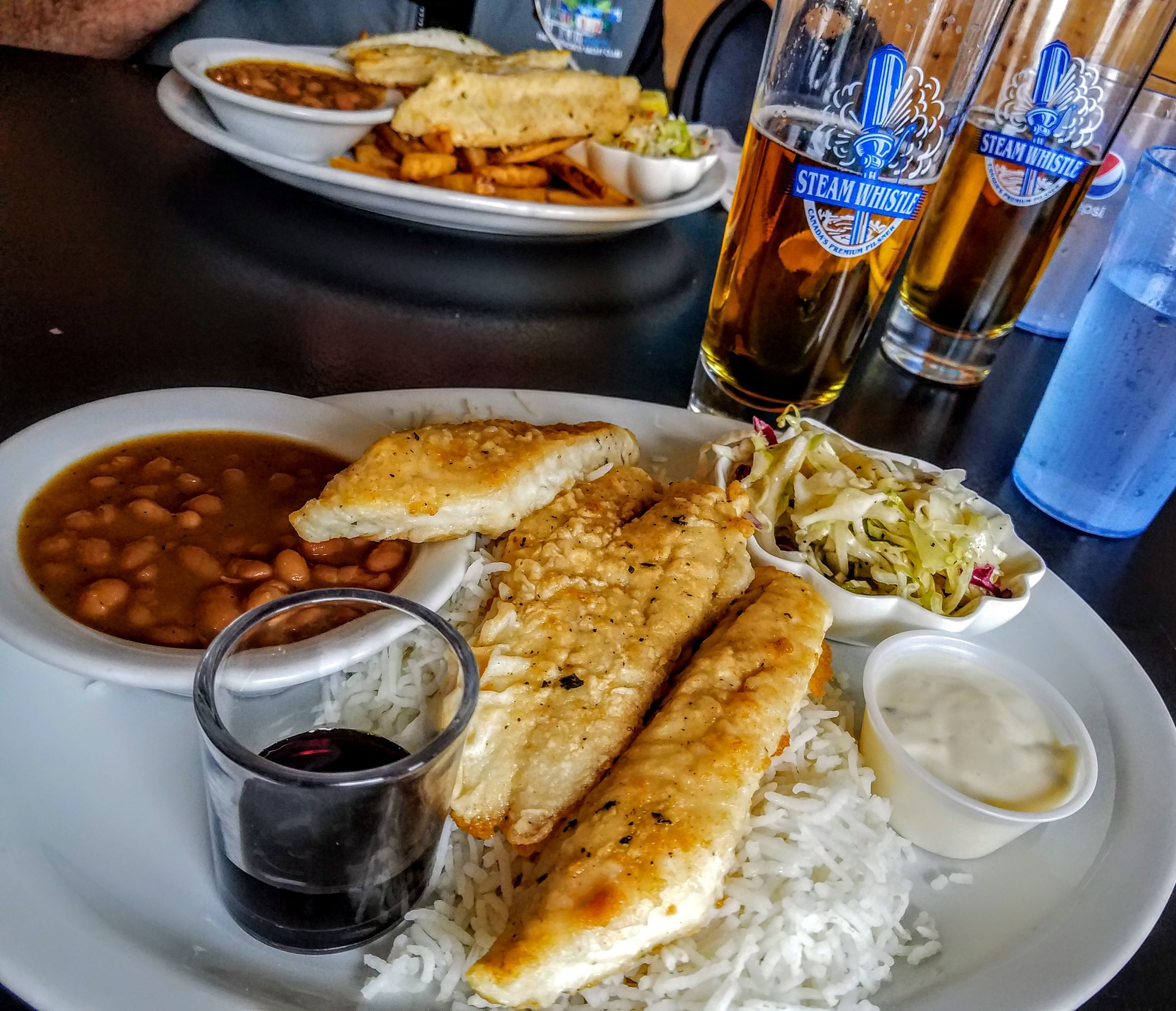 Pickerel with basmati rice and Steam Whistle Beer…we visited the brewery in Toronto