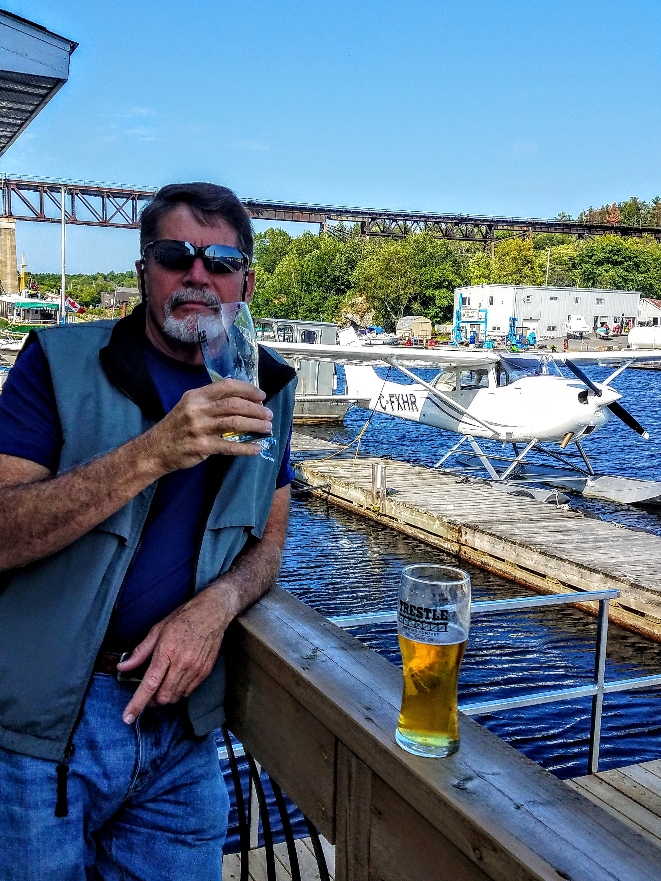 A Trestle Beer in front of the trestle while you await your seaplane tour