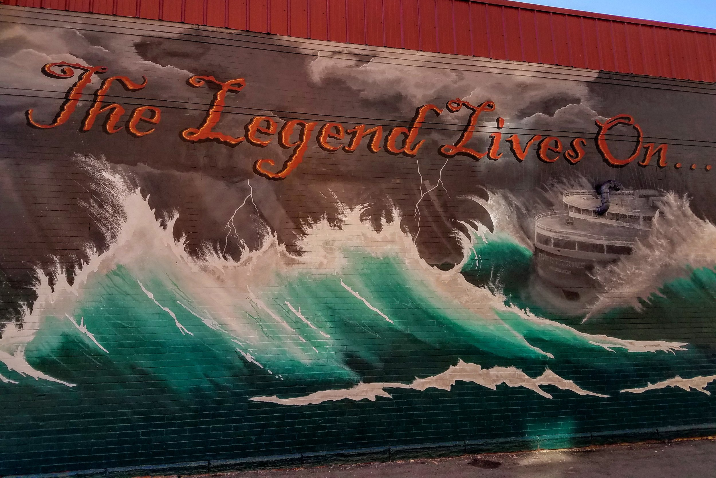 The wreck of the Edmund Fitzgerald memorialized in this mural on 'The Merch' bars side wall. The manager at the bar relayed his memory of the day it sank back on November 10th, 1975