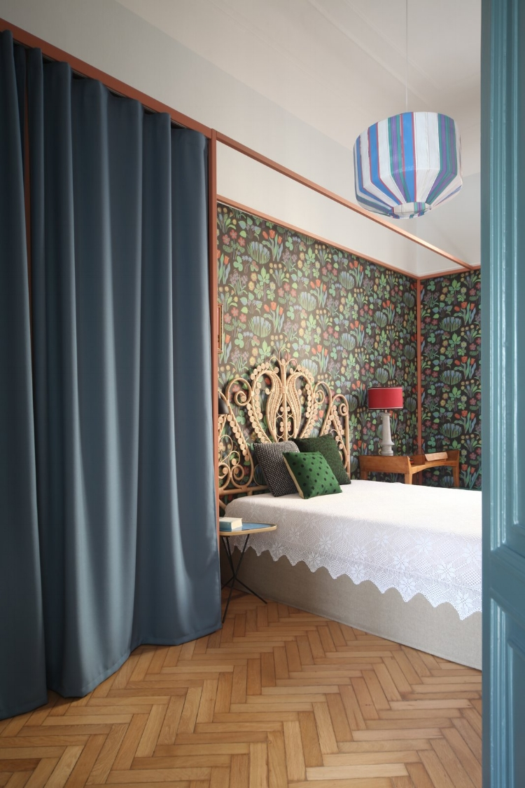 here-is-a-look-at-a-rattan-headboard-by-maison-du-monde-and-a-metallic-frame-wardrobe-designed-by-marcante-testa-with-a-curtain-by-kvadrat-the-suzie-pedant-lamp-is-by-colonel.jpg