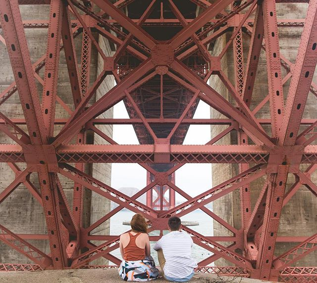 🌉 UGGBO? Doesn't sound as good as the Dumbo in NYC. Underneath the GG Bridge.  #goldengatebridge #engagementphotos