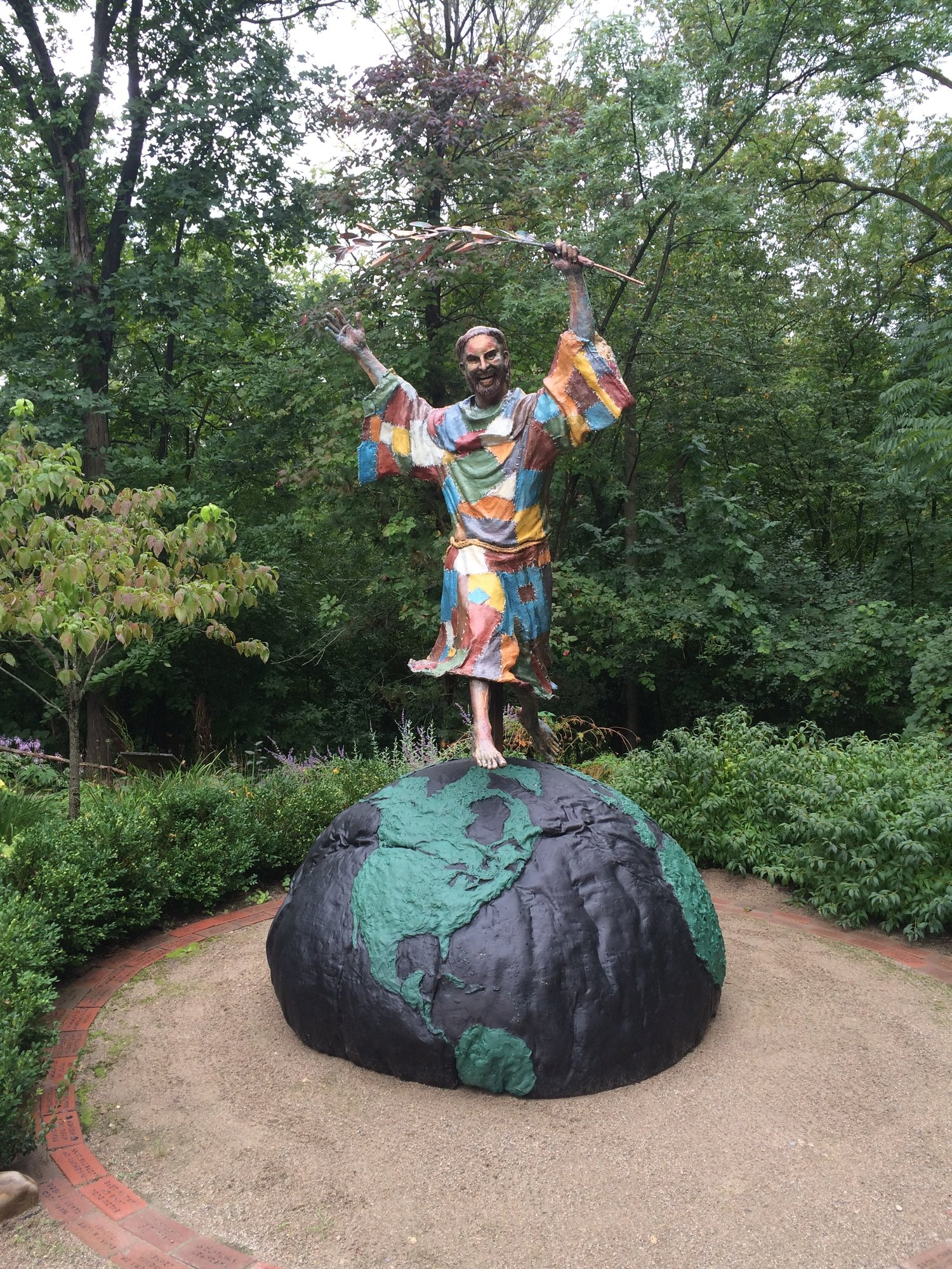 """""""International Peace Statue"""" Saint Francis Leaping over the World. Located at the Saint Francis Sculpture Garden. 2025 East Fulton at the Dominican Center at Marywood. This sculpture is available to Buy or Rent or have cast in Bronze."""