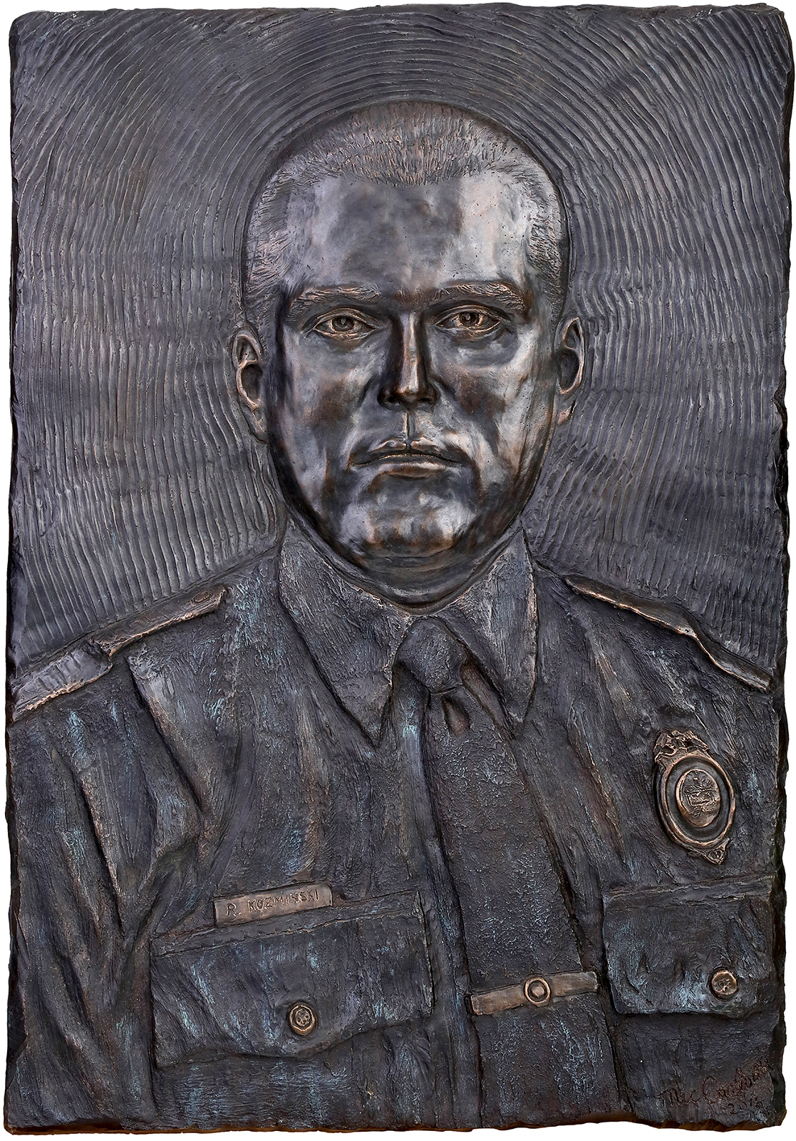 "Officer Robert Kozminski - Original 24"" x 30"" Bronze24"" x ""30 and 9"" x 12"" replicas hand made by Mic available to purchase please Call or email MicMemorial Location Richmond Park Grand Rapids, Michigan."