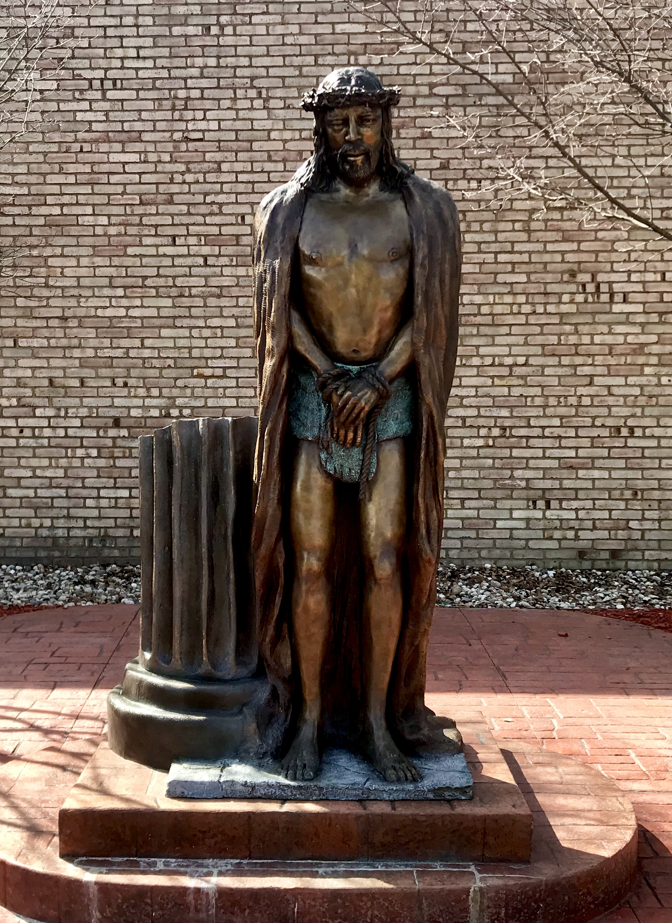 """""""Christ at the Pillar"""" bronze is located in the courtyard at Holy Redeemer Church. 2700 Baldwin St., Jenison, Michigan."""