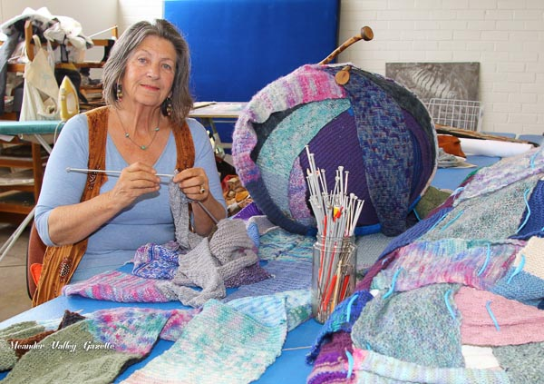 Nicey Brown turning long scarf into rugs for refugees