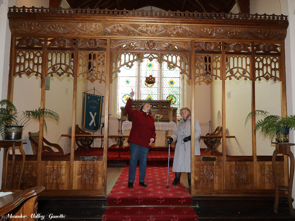 Pat Hobman, secretary of Parish Council and Shirley Hancox retired Parish Council member, both of Westbury, view the magnificent Nellie Payne carving 'Seven Sisters Screen'. Nellie, one of nine daughters, carved this piece in memory of her 7 deceased sisters when she was 72. Installed in 1938, the screen is one of many significant carvings by Nellie located in the Anglican Church in Westbury. The church will hold an open day on the 21st July for people wanting to view the works.