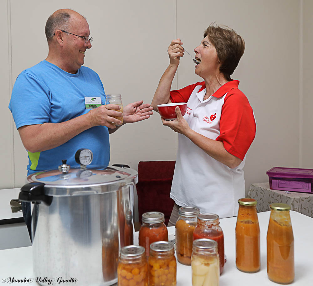 David Hudson from Harvest Helpers tests the newly-preserved produce with Elena Olah from Deloraine House. Photo by Mike Moores