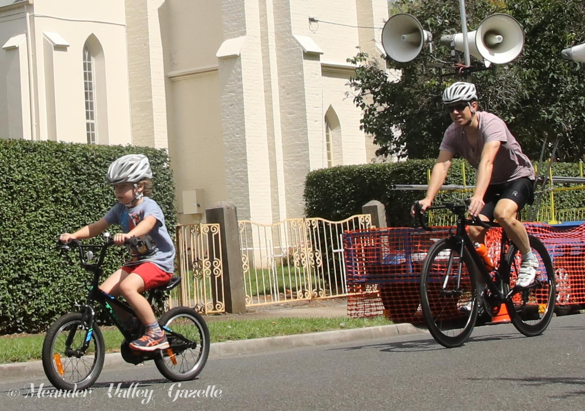 Kayne 7yrs enjoys the community ride with dad Greig Watson.